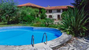 Character property in good order retaining original features in mature garden with swimming pool.